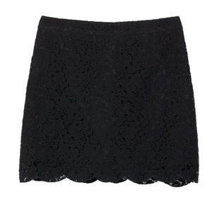 Talula Etta Lace Scalloped Mini Skirt from Aritzia